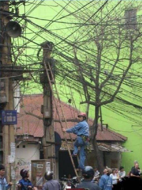 Electrician in China at work